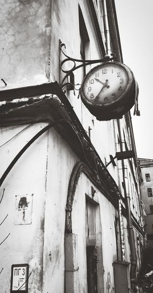 Low angle view of clock on old building
