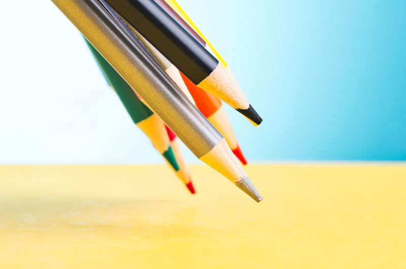 colourful pencils over beautiful reverberation gradient background Still Life Pencil No People Close-up Yellow Writing Instrument Focus On Foreground Indoors  Multi Colored Art And Craft Sharp Craft Studio Shot Selective Focus Copy Space Orange Color Metal Vibrant Color Colored Pencil Wood - Material Art And Craft Equipment