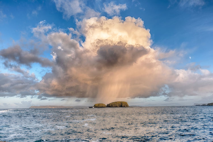 Sheep Island erupting during a hail storm. North Antrim coastline, Ireland. Rathlin Island in the distance. Game Of Thrones Sheep Island Ballintoy Fairhead Hailstorm Weather Atmospheric Mood Beauty In Nature Cloud - Sky Clouds And Sky Day Eruption Horizon Over Water Nature No People Outdoors Rathlin Island Scenics Sea Sky Sunlight Tranquil Scene Tranquility Water Waterfront