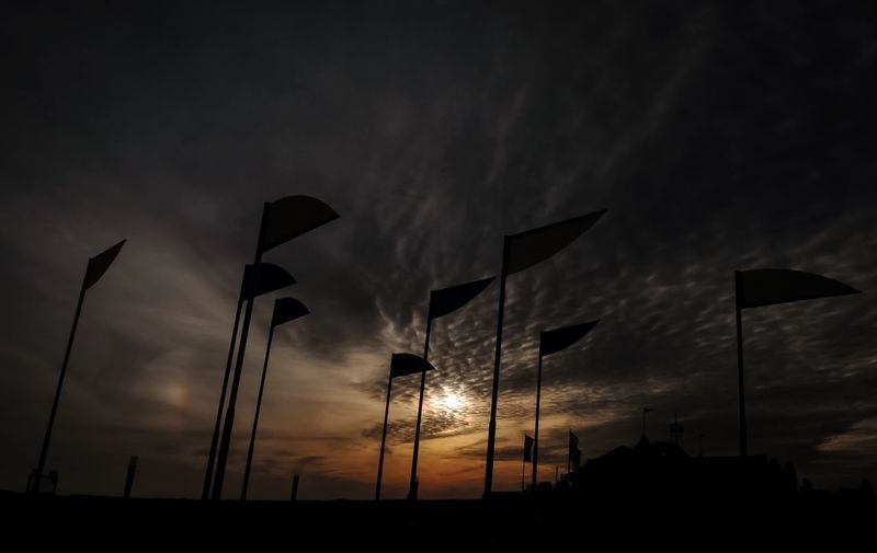 Wind 💨 Sky Sunset Cloud - Sky Silhouette Low Angle View No People Nature Flag Beauty In Nature Dark