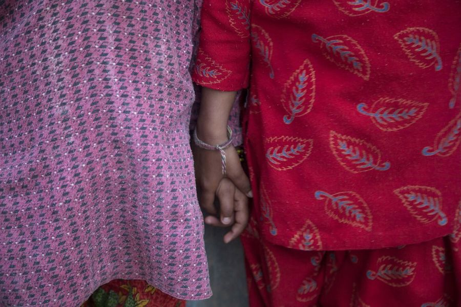 Holding Hands Nepal Sisters Close-up Day Human Hand Pattern Real People Red Sari Traditional Clothing Village Life Wedding Women