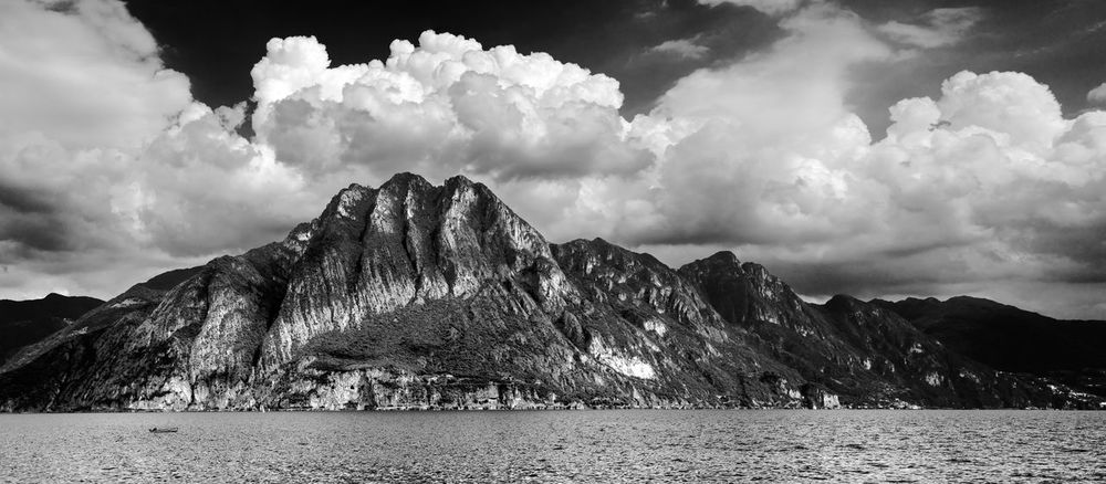 Tranquility at Riva Di Solto Cloudscape Beauty In Nature Cloud - Sky Day Lake Mountain Mountain Range Nature No People Outdoors Physical Geography Rock - Object Scenics Sky Tranquil Scene Tranquility Water