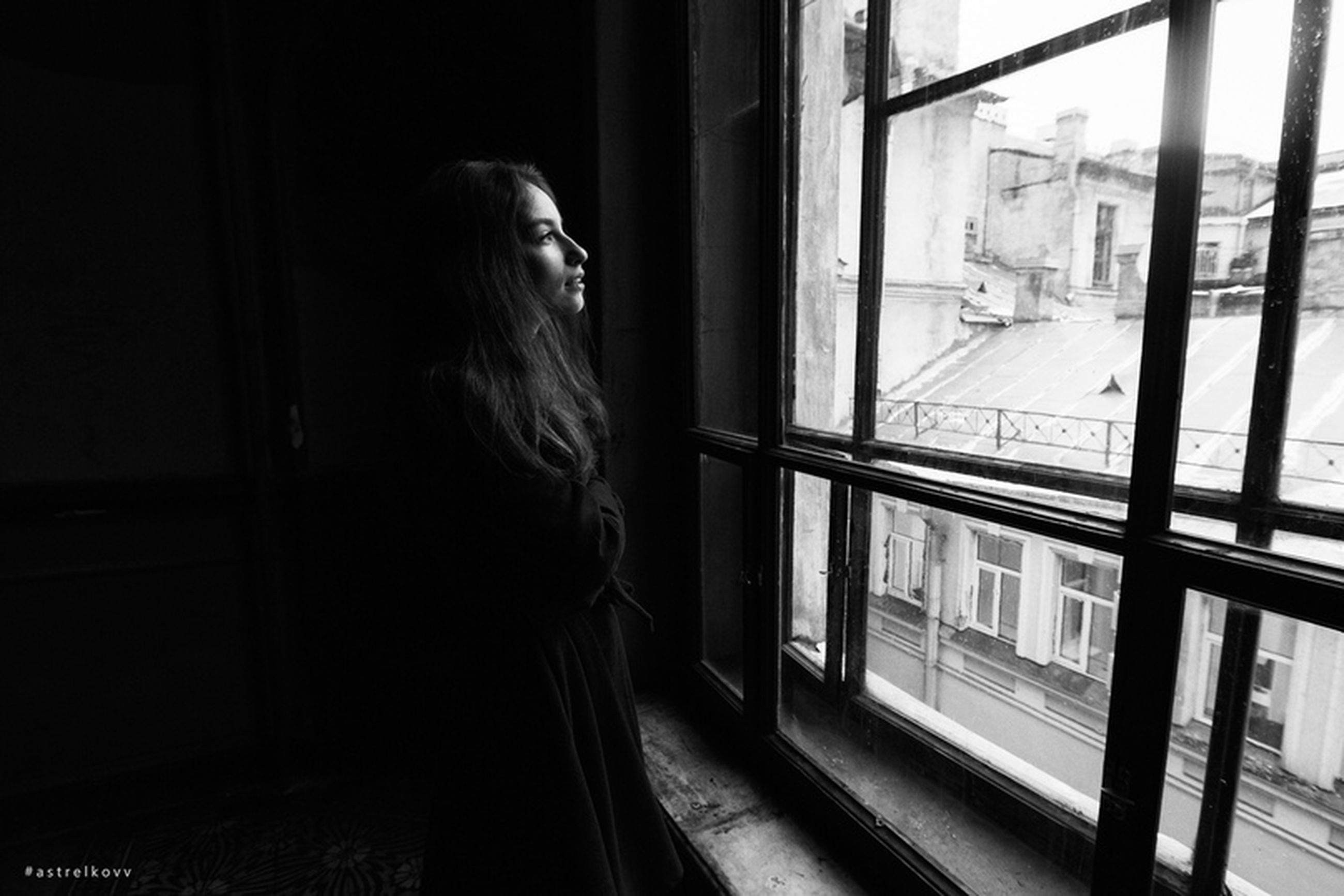 one person, window, real people, indoors, lifestyles, standing, long hair, leisure activity, hair, glass - material, hairstyle, casual clothing, looking, women, architecture, young adult, young women, day, transparent, contemplation