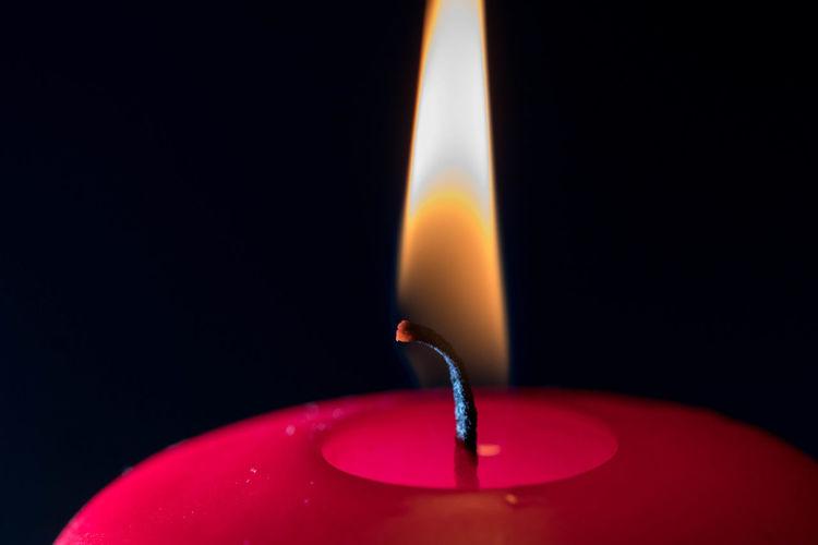 EyeEm Best Shots EyeEm EyeEm Best Pics Eye4photography  Close-up Flame Burning Fire Studio Shot Indoors  Illuminated Red Black Background Single Object Candle Red Candle Detail Still Life Minimalism Minimalobsession Minimalist Wax