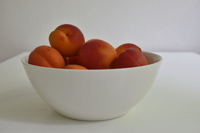 Apricot Bowl Close-up Food Food And Drink Freshness Fruit Group Group Of Objects Healthy Eating Indoors  Medium Group Of Objects No People Orange Color Ripe Still Life Table White Background White Color