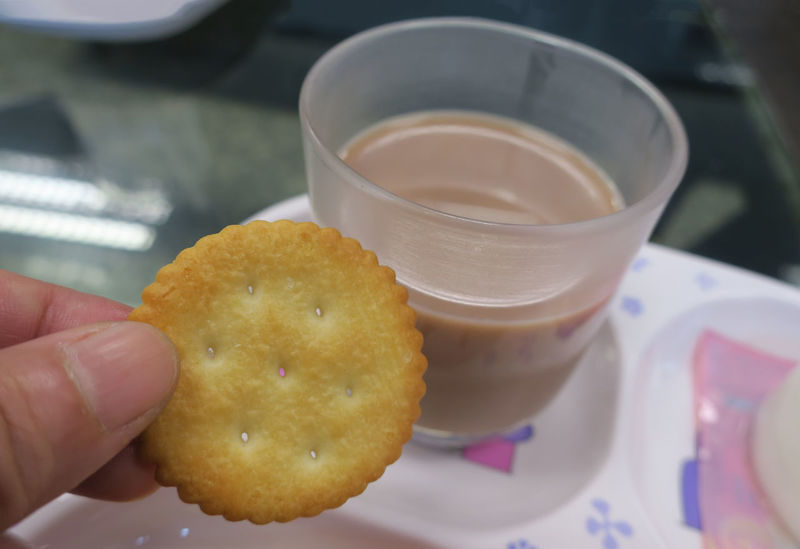 HotDrink Biscuit Break Time Close-up Craker Day Drink Easy Energy Food Food And Drink Freshness Holding Human Body Part Human Hand Indoors  One Person Plate Ready-to-eat Real People Refreshment Simple Food Stories
