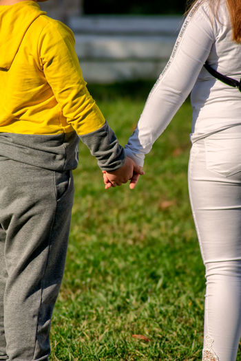 Rear view of couple holding hands
