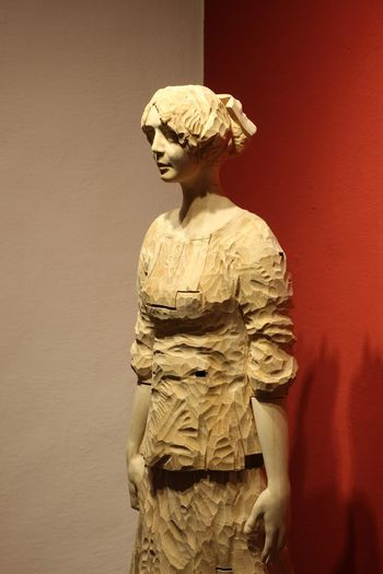 Statue of women against wall red