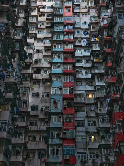 Facade of a residential building in hong kong showing small balconies and tight space