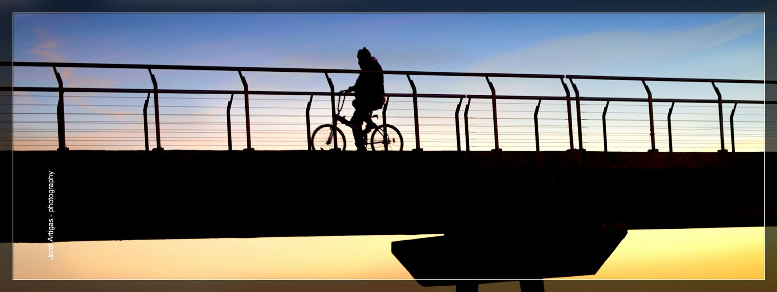 silhouette, full length, men, lifestyles, bicycle, leisure activity, low angle view, railing, clear sky, transportation, sky, built structure, side view, jumping, sport, riding, architecture, standing
