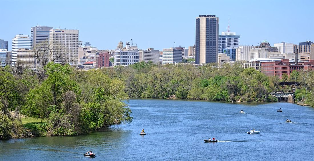 A cityscape along the James River with a view of the Richmond, Virginia skyline in the spring. City City Life Cityscape EyeEm Best Shots James River Outdoors Pjpink River Travel Destinations Urban Skyline Water Waterfront