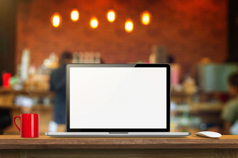 Laptop computer blank screen on wooden table and blurred Coffee shop interior background with bokeh image, for product display montage,can be used for montage or display your products. Laptop Desk Computer Screen Background Mock White Blank Table Up Home View Notebook Work Design Desktop Business Office Style Young Technology Workspace Workplace Phone Space Mobile Modern Creative Old Isolated Open Display Portable Object Nobody Single Digital Equipment Communication Internet Silver  Coffe Shop Coffee Bar Businessman Beautiful Professional Restaurant Mockup