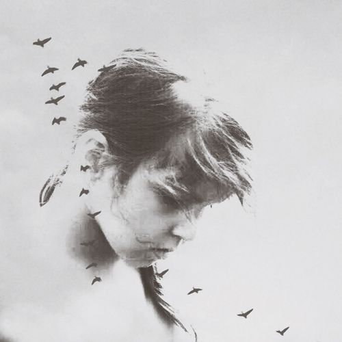 Double exposure of girl and birds against white background