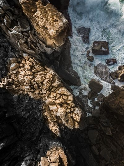 Beach Full Frame Water Sunlight Close-up Sky Rugged Rocky Coastline Textured  Rocky Mountains Rock Formation Coast Rock Geology Shore Tide Rock - Object