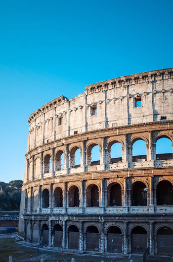 Amphitheater Ancient Arch Architectural Column Architecture Blue Built Structure Capital Cities  Clear Sky Coliseum Column Culture Day Exterior History Low Angle View No People Old Old Ruin Outdoors The Past Tourism Travel Destinations