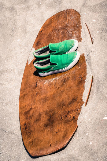 Shoes and wood on sand