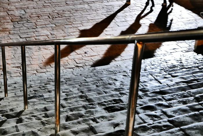 Shadow of people walking down stairs at night Stairs Stone Stairs Shadow People Against The Light