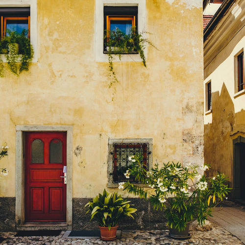 Radovlicja Radovlicja Red Slovenia Architecture Building Building Exterior Built Structure Door Entrance Flowering Plant House No People Plant Potted Plant Squarecrop Window