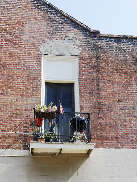 Modern America II. America American Flag Architecture Balcony Balcony View Brick Wall Building Exterior Built Structure Daily Life Day Flag Flower Grill House Modern America No People Observer Outdoors Perspective Sky Solitude Window