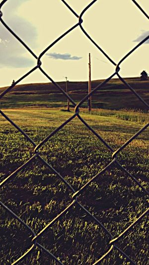 Chainlink Fence Protection Safety Security Field Landscape Rural Scene Sky No People Nature Sunset Outdoors Day Grass Close-up