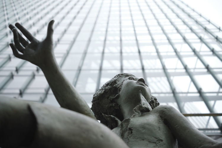 Low angle view of hand statue