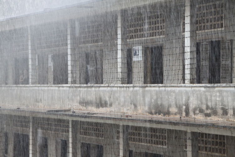 Monsun Rain Architecture Backgrounds Building Exterior Built Structure City Concrete Day Full Frame Gray Nature No People Outdoors Prison Reflection Tuol Sleng Genocide Museum Wall Wall - Building Feature Window