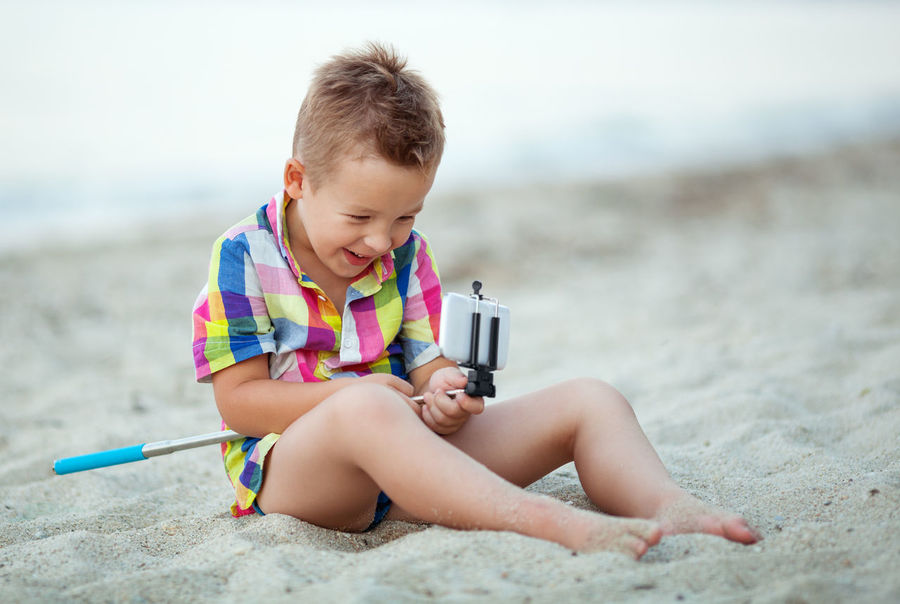 Beach Boy Boys Camera Caucasian Child Childhood Happiness Horizontal Kid Make Photo Mobile Ocean Outdoor Phone Self-portrait Selfie Selfie Stick Smartphone Stick