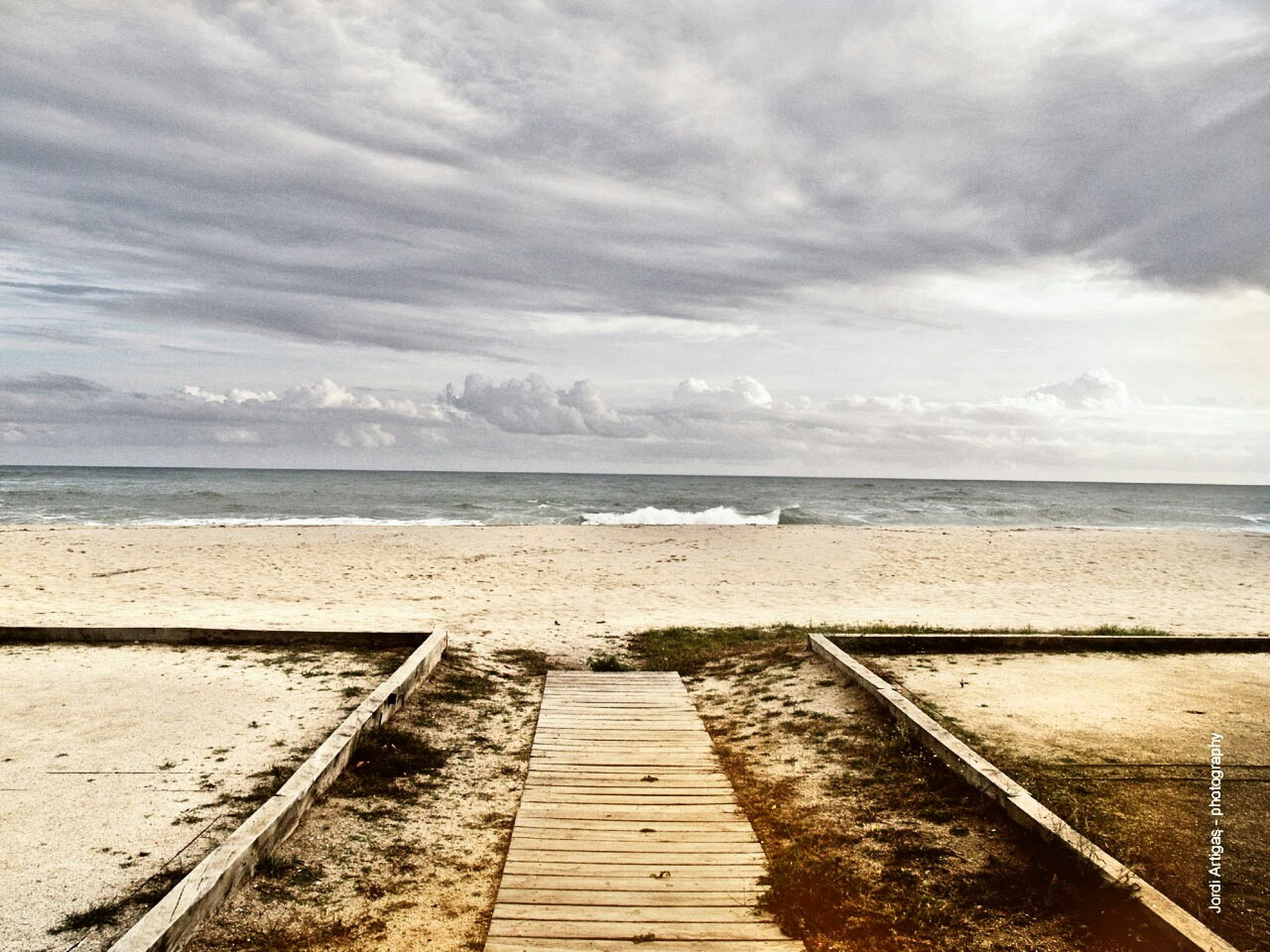 sea, horizon over water, water, beach, boardwalk, the way forward, tranquility, tranquil scene, sky, scenics, beauty in nature, summer, pier, vacations, idyllic, nature, cloud, coastline, cloud - sky, ocean, calm, shore, seascape, tourism, day, majestic, jetty, tide, cloudscape, no people