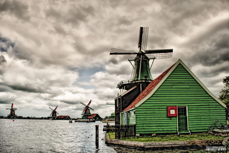 Zaanse Schans Architecture Building Building Exterior Built Structure Cloud - Sky Day Environment Nature No People Outdoors Renewable Energy Sky Traditional Windmill Water Wind Power Wind Turbine