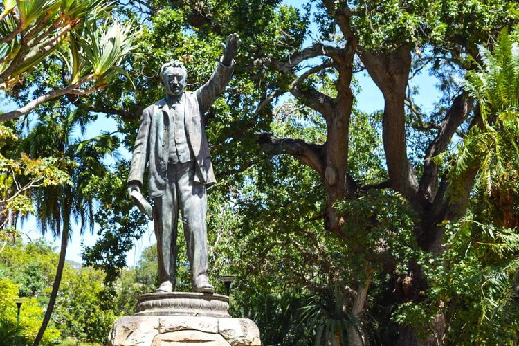 "Rhodes Statue Companys Garden Cape Town South Africa History Colonialism Cecil Rhodes satue in Companys Garden. ""Your hinterland is there"" is written there, showing the way to Cairo"