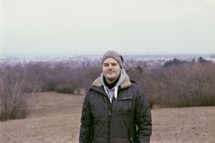 Portrait of mature man wearing warm clothing while standing on land