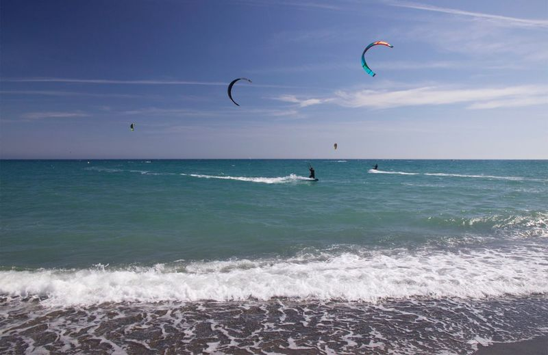 Kite surfers Sea Horizon Over Water Extreme Sports Adventure Leisure Activity Real People Kiteboarding Nature Kites Kitesurfing Beauty In Nature Scenics Water Vacations Sky Wave Parachute Lifestyles Beach Motion Day