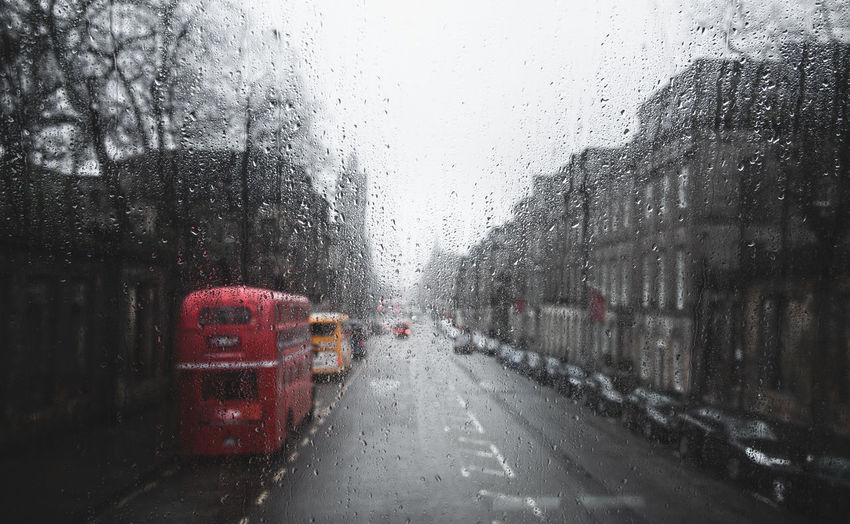 Full frame shot of wet bus window during rainy season