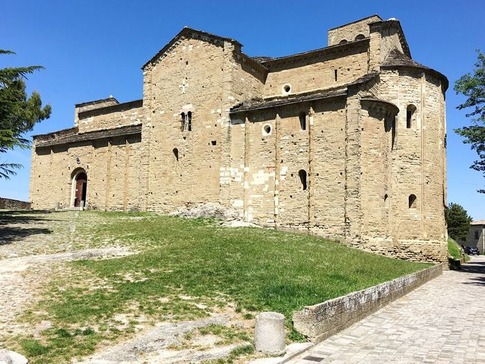 Architecture History Built Structure Building Exterior Day Real People Ancient Outdoors Clear Sky Walking Low Angle View Castle Sunlight Full Length One Person Sky Ancient Civilization People Duomo Church San Leo Montefeltro