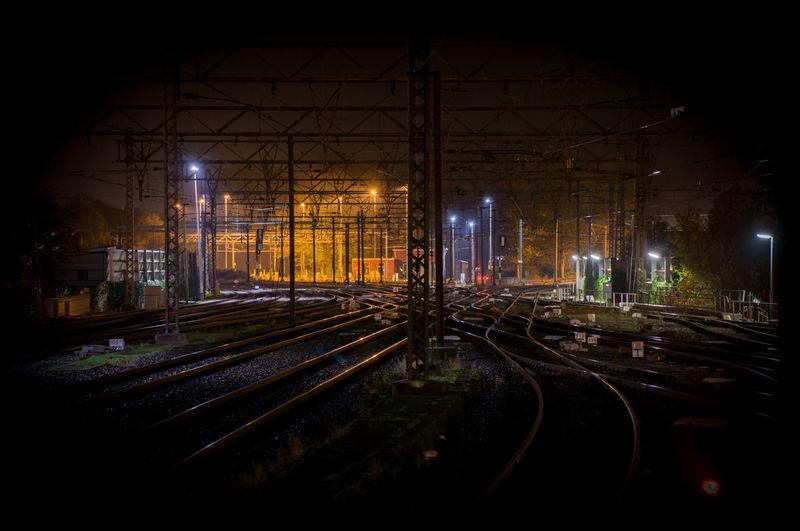 Railroad tracks on field at night