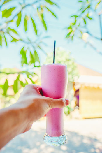 Body Part Close-up Dairy Product Day Drink Drinking Straw Finger Focus On Foreground Food Food And Drink Freshness Frozen Food Glass Hand Holding Human Body Part Human Hand Ice Cream One Person Pink Color Real People Refreshment Straw Sweet Food Temptation