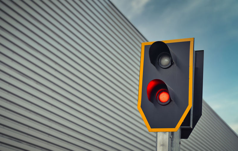 Close up of a train traffic light which is set to red