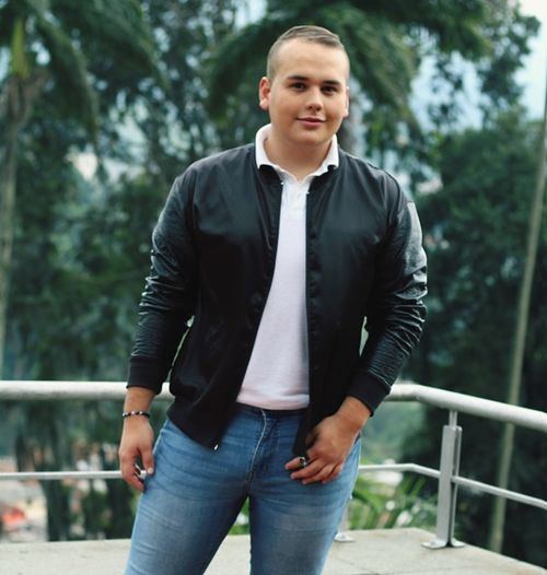 Portrait Men Smiling Front View Mid Adult Jeans Arts Culture And Entertainment City Casual Clothing