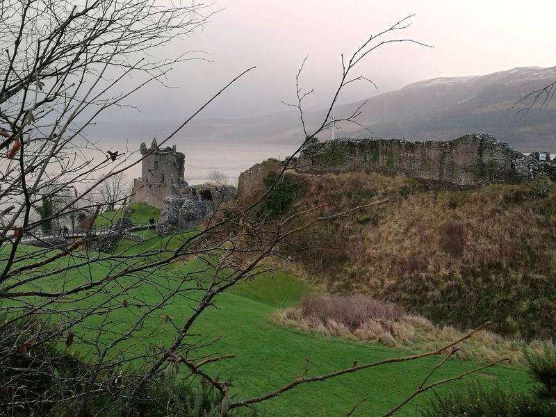 Nature Outdoors Landscape Grass Beauty In Nature Tree Castles UrquhartCastle Accidents And Disasters Plant Sunset Social Issues No People City Day Natural Disaster Sky