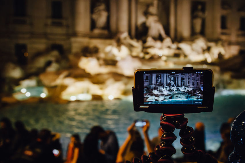 Making a video at the Fontana di Trevi #urbanana: The Urban Playground Fontana Di Trevi HUAWEI Photo Award: After Dark Travel Activity Architecture Communication Crowd Famous Place Focus On Foreground Group Of People IPhone Illuminated Light Mobile Night Nightlife Photography Themes Real People Screen Technology Travel Destinations Video Wireless Technology