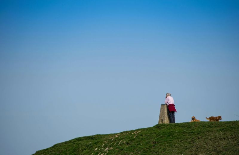 Man Standing On Hill