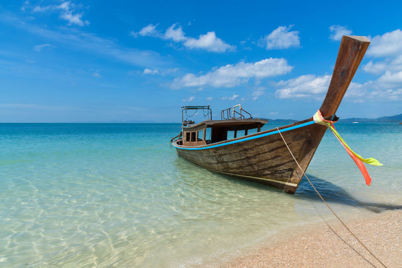 Stunning seascape scene in Thailand with lone long tail boat and clear turquoise ocean Peaceful Lost No People Copy Space Ocean Paradise Asian  Beautiful Beautiful Nature Dream Dream Vacation Exotic Thailand Tropical Paradise Awesome Blue Sky And White Clouds Clear Water Ideal Idyllic Landscape Longtailboat Scenic View Seascape Stunning View Thailandtravel Tropical Destination Turquoise Water