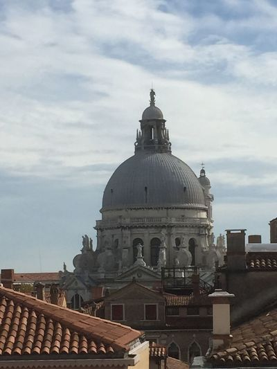 The dome of the church of Santa Maria Della Salute, Venice across the rooftops Architecture Built Structure Building Exterior Cloud - Sky Sky Dome Place Of Worship Religion Day Spirituality Outdoors No People Santa Maria Della Salute Venice, Italy Venice Rooftop View  Church