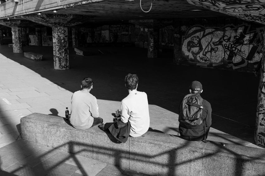 Halved Blackandwhite Blackandwhite Photography EyeEm Gallery Friendship Men Outdoors People Real People Sitting Street Streetphoto_bw