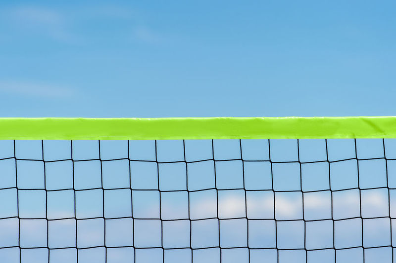 Low angle view of blue sky seen through fence