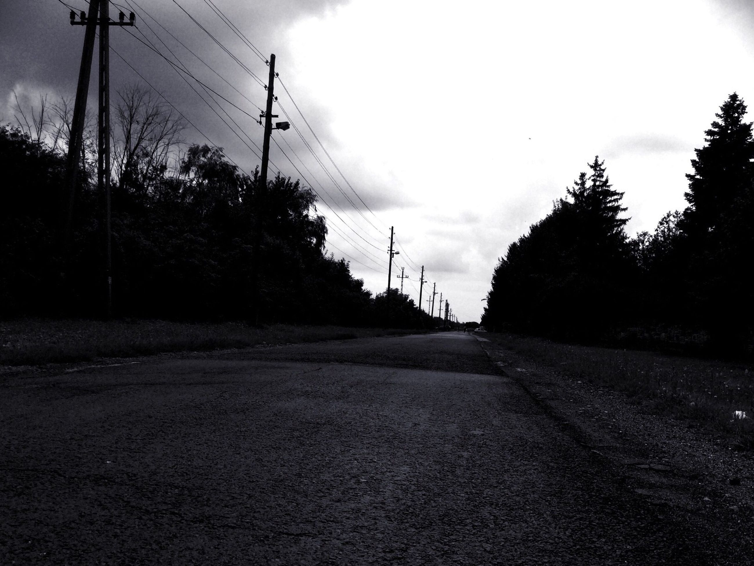 electricity pylon, the way forward, power line, transportation, sky, tree, silhouette, connection, road, electricity, power supply, tranquility, cable, tranquil scene, street, nature, vanishing point, sunset, diminishing perspective, outdoors