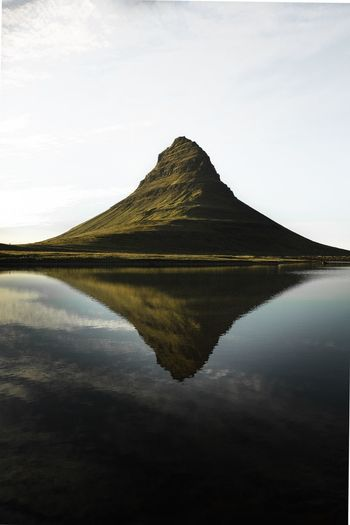 Scenic view of lake reflecting mountain and sky