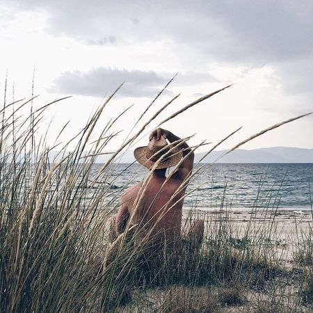Sea Water Cloud - Sky Sky Horizon Over Water Nature One Person Beach Tranquil Scene Outdoors Leisure Activity Tranquility Grass Full Length Scenics Marram Grass Beauty In Nature Day Sand Vacations Getty Images Summer Summertime EyeEm Selects Sommergefühle Breathing Space