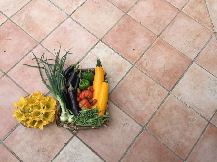A basket of vegetables from the garden. Zucchini Carrot Cornucopia Day Flower Flowers Food Food And Drink Freshness Garden Healthy Eating High Angle View Indoors  No People Onion Spring Onion Squash Still Life Supermarket Tile Tomato Variation Vegetable Vegetables