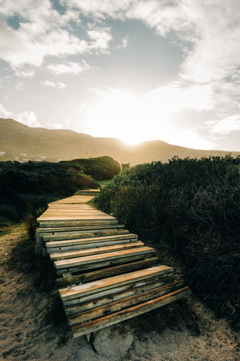 Stairs Beach Beauty In Nature Cloud - Sky Day Environment Field Growth Land Landscape Mountain Nature No People Non-urban Scene Outdoors Pathway Plant Scenics - Nature Sky Sunlight Tranquil Scene Tranquility Wood - Material
